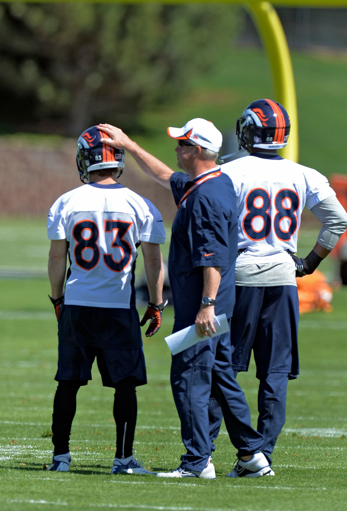 . Head Coach John Fox of the Denver Broncos taps wr Wes Welker (83) on the helmet during the teams OTAs May 20, 2013 at Dove Valley. All offseason training activities (OTAs) are voluntary until the mandatory minicamp June 11-13. (Photo By John Leyba/The Denver Post)