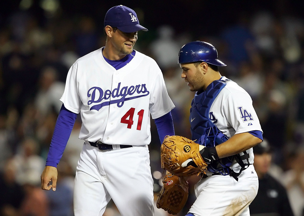 . AARON SELE -- Pitcher Aaron Sele #41 and catcher Russell Martin #55 of the Los Angeles Dodgers celebrate on the mound after the Dodgers\' victory against the Florida Marlins on August 15, 2006 at Dodger Stadium in Los Angeles, California.     (Photo by Lisa Blumenfeld/Getty Images)