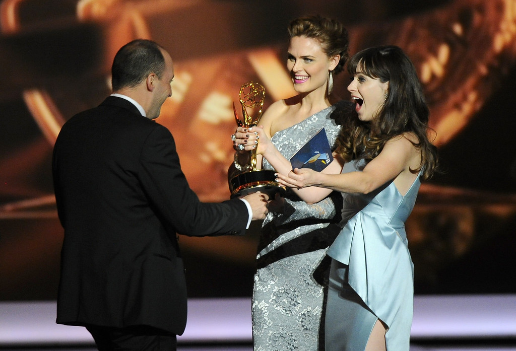 . Zooey Deschanel, right, and Emily Deschanel present the award for outstanding supporting actor in a comedy series to Tony Hale, left, on stage at the 65th Primetime Emmy Awards at Nokia Theatre on Sunday Sept. 22, 2013, in Los Angeles.  (Photo by Chris Pizzello/Invision/AP)