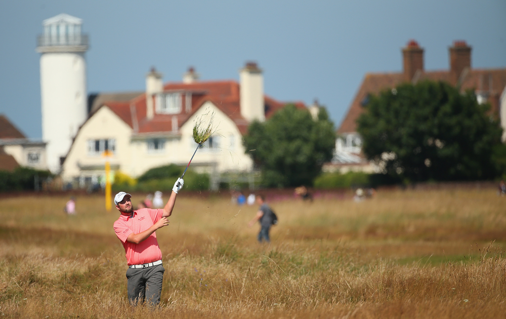 . Marc Leishman of Australia hits from the rough during the first round of The 143rd Open Championship at Royal Liverpool on July 17, 2014 in Hoylake, England.  (Photo by Mike Ehrmann/Getty Images)