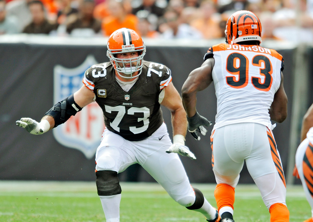 . Cleveland Browns tackle Joe Thomas (73) takes on Cincinnati Bengals defensive end Michael Johnson (93) in the second quarter of an NFL football game Sunday, Sept. 29, 2013, in Cleveland. The game was the 100th of Thomas\' NFL career. (AP Photo/David Richard)