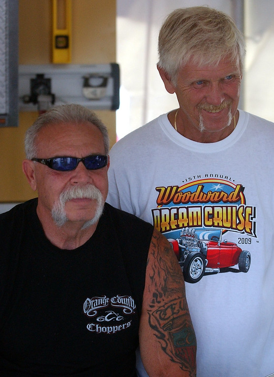 . (left) Paul Teutul, Sr., star of the televison series Orange County Choppers, has his picture taken with Ron Campbell while making an appearance during the 16th Annual Woodward Dream Cruise in Royal Oak. (Oakland Press Photo/Vaughn Gurganian)