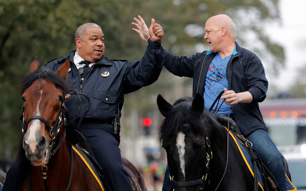 . New Orleans Mayor Mitch Landrieu, right, and chief of police Michael Harrison ride on horseback at the start of the Krewe of Zulu parade on Mardi Gras day in New Orleans, Tuesday, Feb. 13, 2018. (AP Photo/Gerald Herbert)