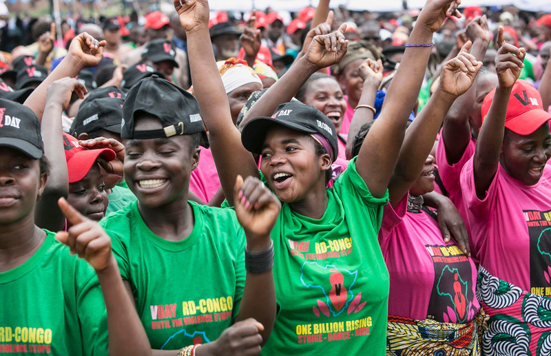 ". Congolese women cheer during the global rally ""One Billion Rising\"" which is part of the V-Day event calling for an end to gender-based violence, in Bukavu February 14, 2013. V-Day is a global activist movement to end violence against women and girls. REUTERS/Jana Asenbrennerova"