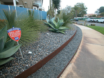 Face-lift with xeriscape, rocks and facia