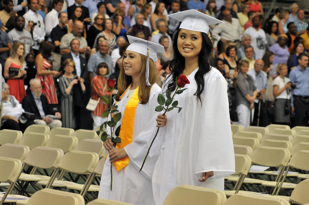 . Two-by-two graduates enter Villanova\'s Pavilion for their graduation from Radnor High School on Wednesday, June 10, 2015. (Stephanie Peditto/Main Line Times)