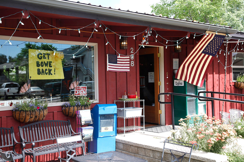 . Pfc. Bowe R. Bergdahl worked as a barista at Zaney\'s River Street Coffee House in this central Idaho resort town just south of the Sawtooth Mountains in Hailey, Idaho on Sunday July 19, 2009, before he enlisted in the Army in 2008. Outside, an American flag hangs from the eaves; along with a sign in the window showing support for Bergdahl. (AP Photo/David Seelig)
