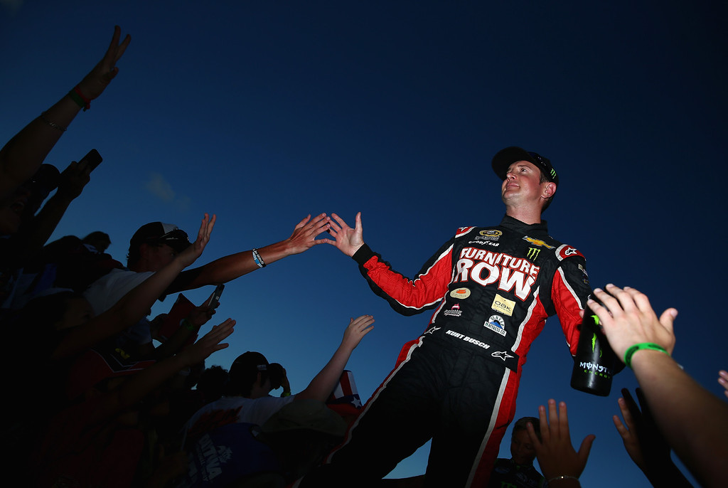 . DAYTONA BEACH, FL - JULY 06:  Kurt Busch, driver of the #78 Furniture Row Racing / Sealy Chevrolet, greets fans during driver introductions during the NASCAR Sprint Cup Series Coke Zero 400 at Daytona International Speedway on July 6, 2013 in Daytona Beach, Florida.  (Photo by Tom Pennington/Getty Images)