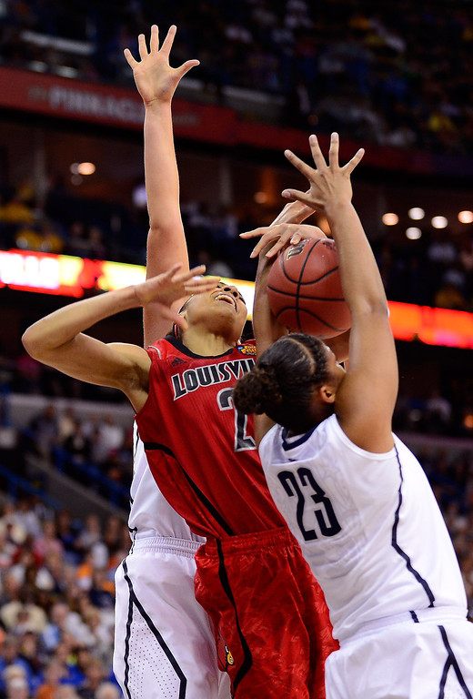 . Bria Smith #21 of the Louisville Cardinals goes up with the ball against Kaleena Mosqueda-Lewis #23 of the Connecticut Huskies in the first half during the 2013 NCAA Women\'s Final Four Championship at New Orleans Arena on April 9, 2013 in New Orleans, Louisiana.  (Photo by Stacy Revere/Getty Images)