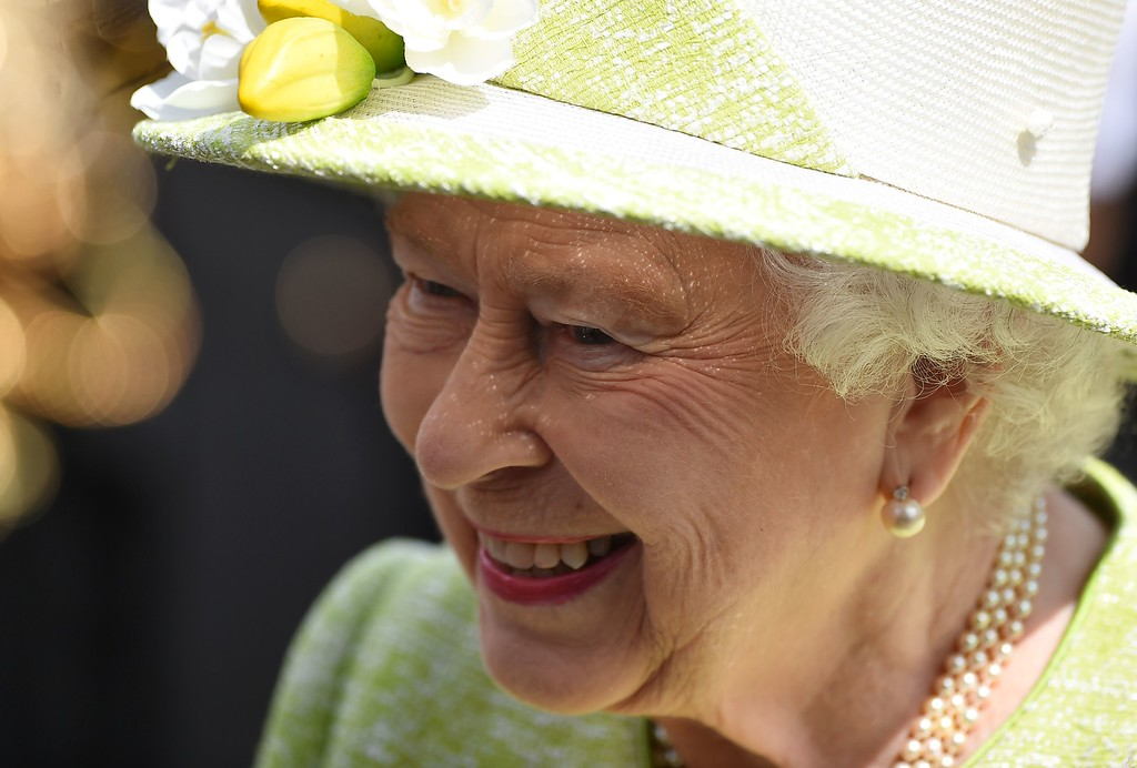 . Britain\'s Queen Elizabeth II greets well-wishers on her 90th birthday in Windsor on April 21, 2016. Britain celebrated the 90th birthday of Queen Elizabeth II on Thursday with tributes to a popular monarch who has steered it through the decline of empire and a wave of scandals to the Internet age. / AFP PHOTO / BEN  STANSALL/AFP/Getty Images