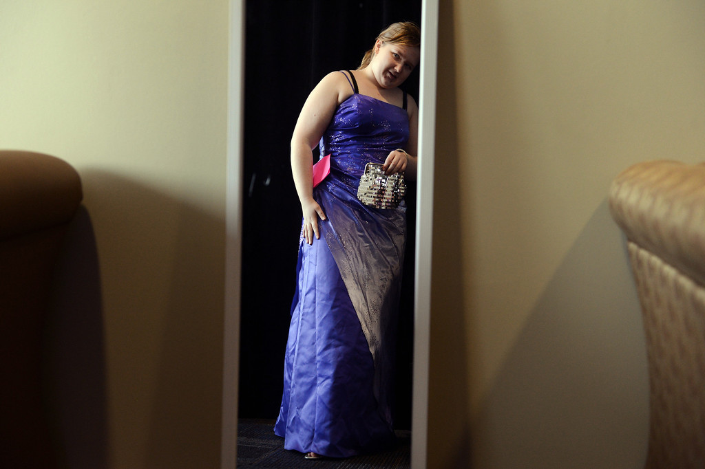 . COMMERCE CITY, CO. - MARCH 16: Jennifer Cline, a senior at Green Mountain High School, admires her dress during the Prom Dress Exchange Corp. event in Commerce City, CO March 16, 2013. With a valid student ID and a suggested $10 donation, teenage girls could chose from 1,356 donated dresses that lined a long hallway at Dick�s Sporting Goods Park. �This is amazing,� Jennifer said. �This is close to the only reason I can go to prom this year.� (Photo By Craig F. Walker/The Denver Post)