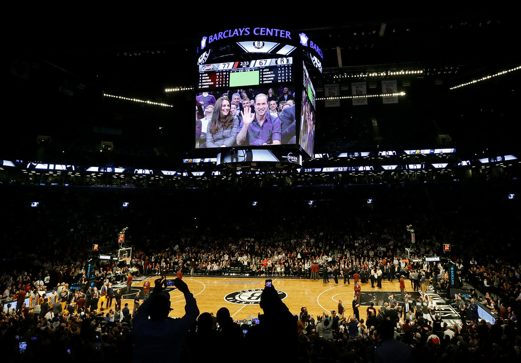 . Britain\'s Prince William, right, and Kate, Duchess of Cambridge, acknowledge the crowd during the second half of an NBA basketball game between the Brooklyn Nets and the Cleveland Cavaliers, Monday, Dec. 8, 2014, in New York. (AP Photo/Frank Franklin II)