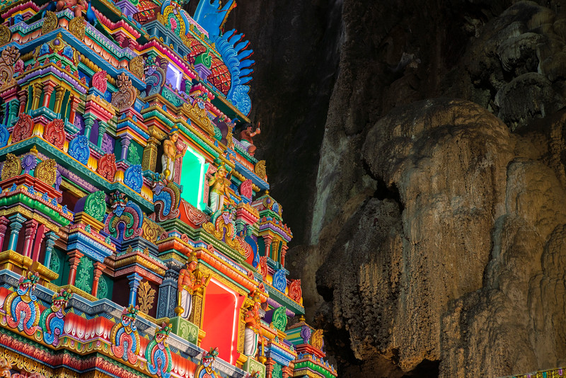 A Hindu Temple stands out against 100 million year old stalagtites in the Cathedral Cave of the Batu Caves, a massive subterranean Hindu temple in Kuala Lumpur.