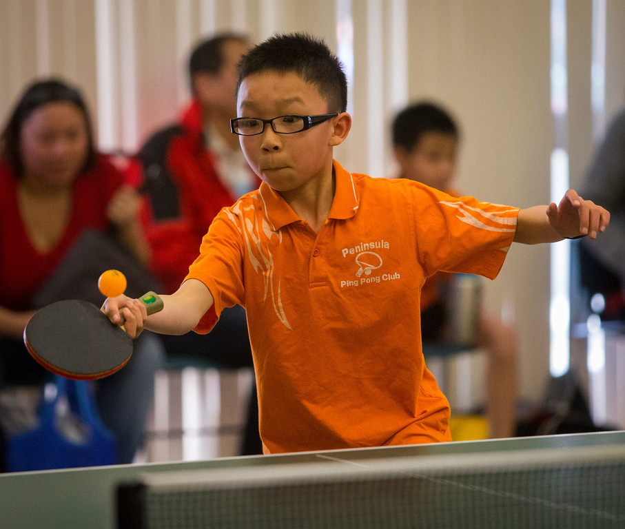 . Aleck Wu, 10, plays in the table tennis tournament at the Lunar New Year Festival.
