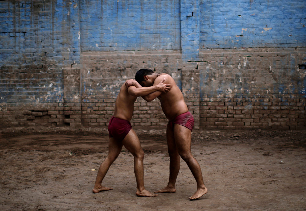 . Pakistani Kushti wrestlers fight in the ring, during their daily training, at a wrestling club in Lahore, Pakistan, Tuesday, Feb. 26, 2013. Kushti, an Indo-Pakistani form of wrestling, is several thousand years old and is a national sport in Pakistan. (AP Photo/Muhammed Muheisen)