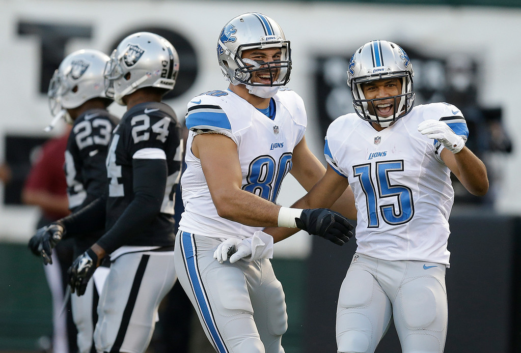 . Detroit Lions wide receiver Golden Tate (15) celebrates after scoring on a 28-yard touchdown reception with tight end Joseph Fauria during the first quarter of an NFL preseason football game against the Oakland Raiders in Oakland, Calif., Friday, Aug. 15, 2014. (AP Photo/Ben Margot)