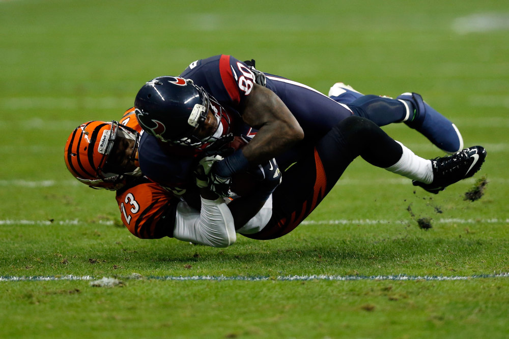 Description of . Andre Johnson #80 of the Houston Texans makes a catch against Terence Newman #23 of the Cincinnati Bengals during their AFC Wild Card Playoff Game at Reliant Stadium on January 5, 2013 in Houston, Texas.  (Photo by Scott Halleran/Getty Images)