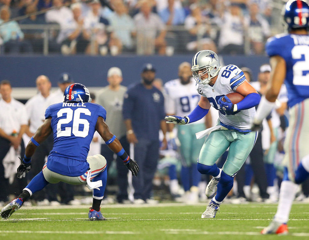 . Tight end Jason Witten #82 of the Dallas Cowboys makes a catch runs after a catch against Antrel Rolle #26 of the New York Giants in the first half on September 8, 2013 at AT&T Stadium in Arlington, Texas.  (Photo by Ronald Martinez/Getty Images)