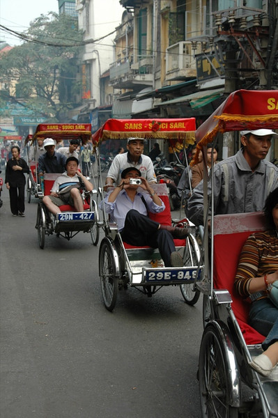 Cyclos on the Street - Hanoi, Vietnam