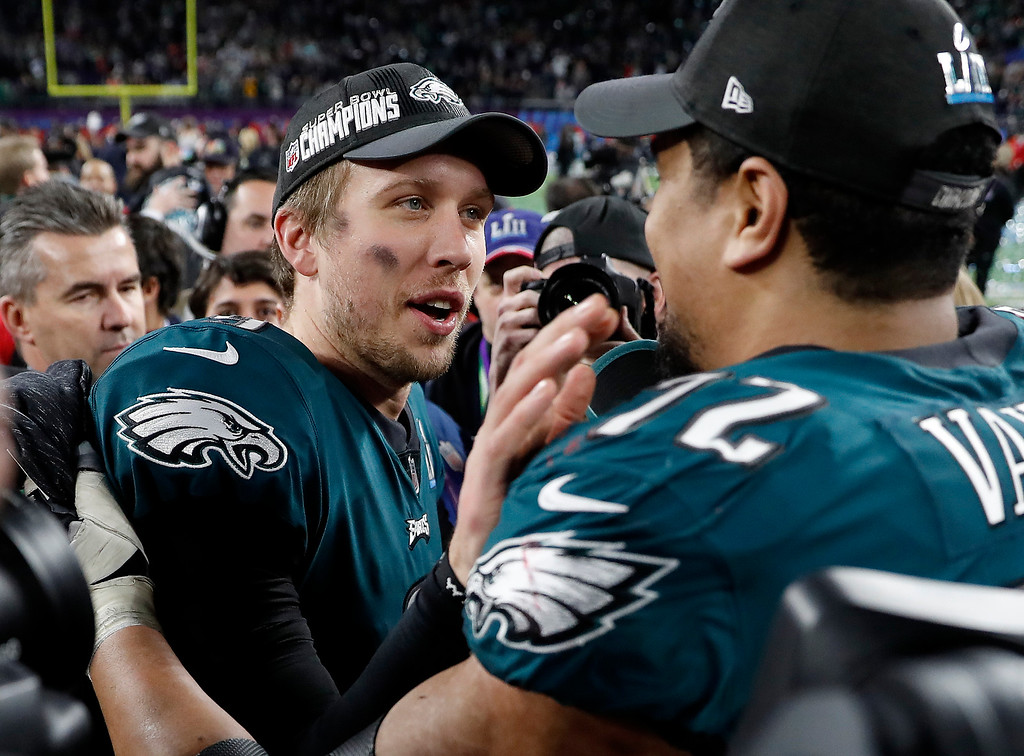 . Philadelphia Eagles\' Nick Foles, left, and Halapoulivaati Vaitai celebrate after the NFL Super Bowl 52 football game against the New England Patriots, Sunday, Feb. 4, 2018, in Minneapolis. The Eagles won 41-33. (AP Photo/Jeff Roberson)