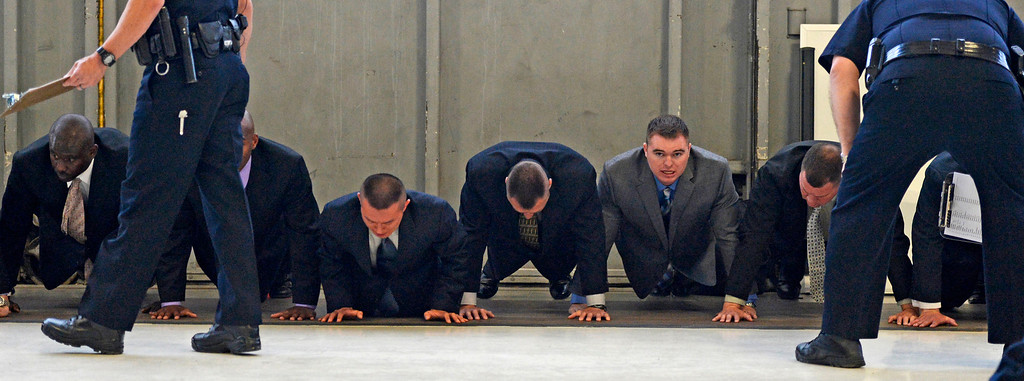 . Recruits do pushups on the first day of police academy training for the Denver Police Department, April 29, 2013.  (Photo By RJ Sangosti/The Denver Post)