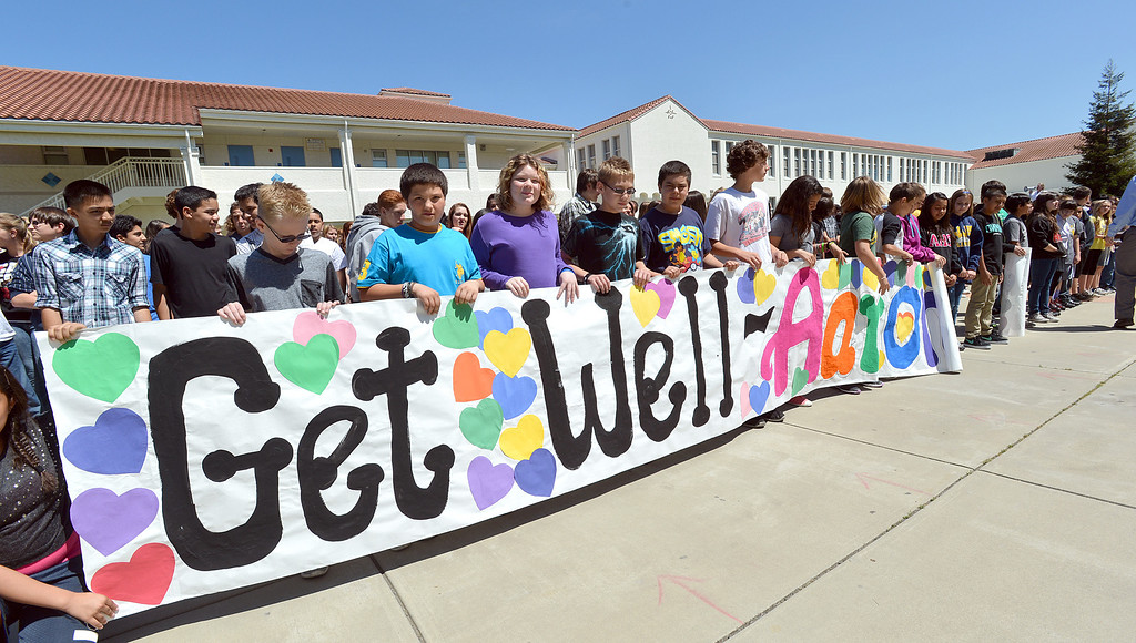 """. Martinez Junior High School students unroll a banner with \""""Get Well Aaron\"""" which was to be used while shooting a video to send well wishes to fellow student Aaron Hern in Martinez, Calif., on Friday, April 19, 2013. Hern is recovering in Boston at Children\'s Hospital after being severely injured at the Boston Marathon explosion last Monday. (Dan Rosenstrauch/Bay Area News Group)"""