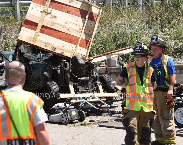 A man was killed Saturday afternoon in Lyndora after the car he was a passenger in crashed into a concrete wall. The driver was severely injured.  photo 1