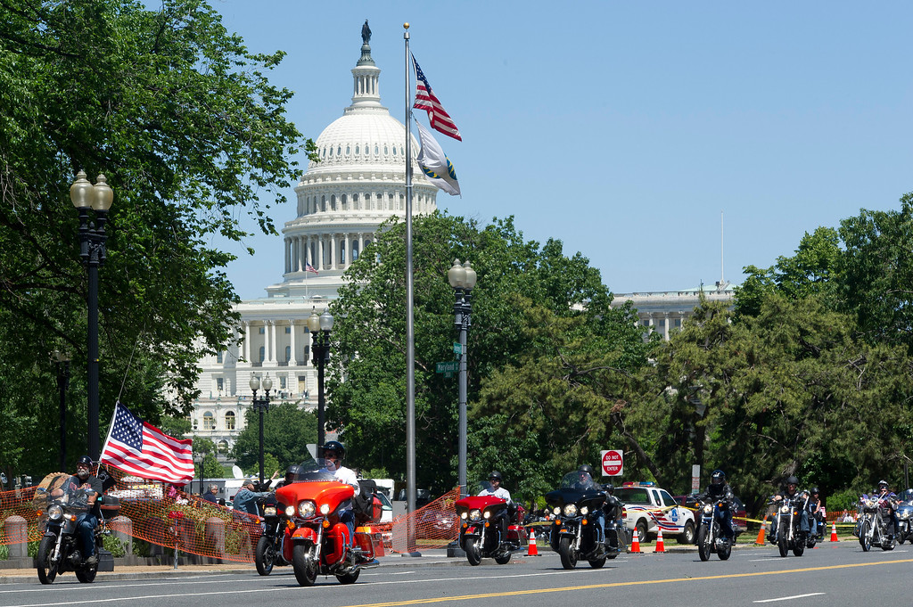 . Motorcyclists ride past the US Congress during Rolling Thunder 2013 in Washington on May 26, 2013. The 26th Annual Rolling Thunder rumbled into he US capital to show support for veterans and those who have fallen in past and present wars. Some one million riders are expected to gather in Washington DC during the Memorial Day weekend.     MLADEN ANTONOV/AFP/Getty Images