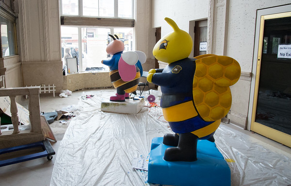 04/30/19 Wesley Bunnell | Staff A New Britain Police Bee being painted by artist Martha Williams along with a bee called Erin Stewart Worker Bee which is being painted by artist James D'Amore stand in towards the front of the project headquarters at 55 West Main St on Tuesday afternoon.