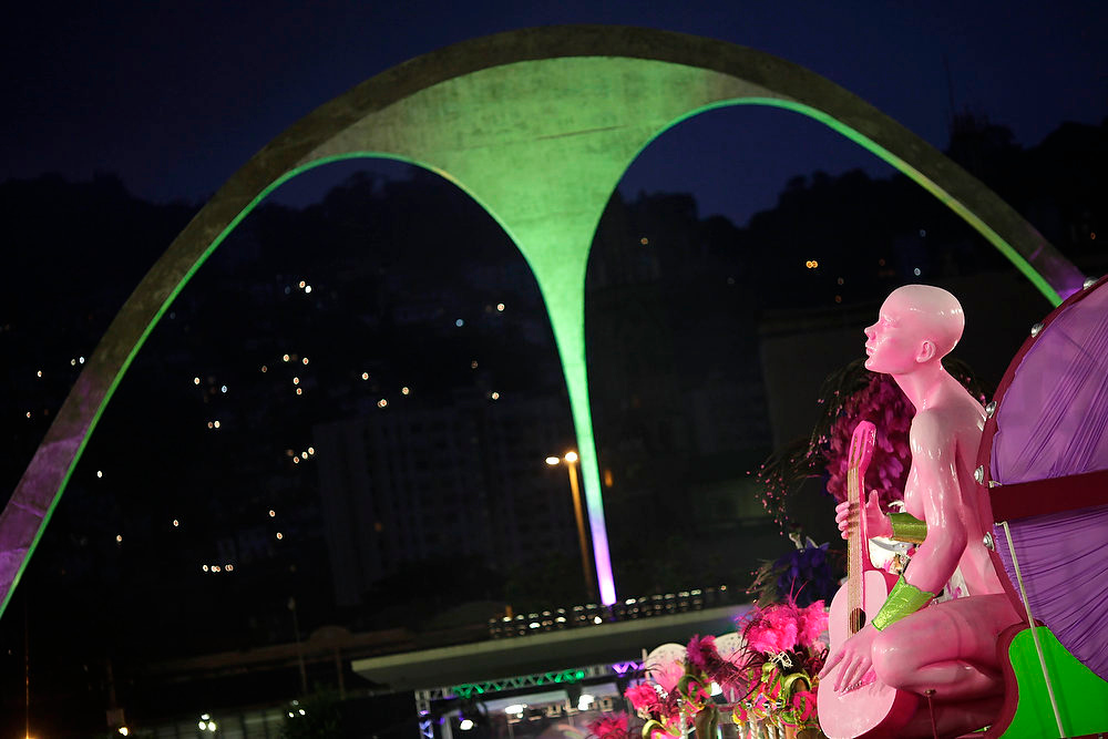 . A float from the Mangueira samba school parades through the Sambadrome, which was designed by architect Oscar Niemeyer, during carnival celebrations in Rio de Janeiro, Brazil on March 7, 2011. According to a hospital spokeswoman on Wednesday, Dec. 5, 2012, famed Brazilian architect Oscar Niemeyer has died at age 104.  (AP Photo/Felipe Dana)