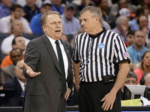 . Michigan State head coach Tom Izzo, left, argues a call during the first half of an NCAA tournament college basketball game against Virginia  in Charlotte, N.C., Sunday, March 22, 2015. (AP Photo/Nell Redmond)