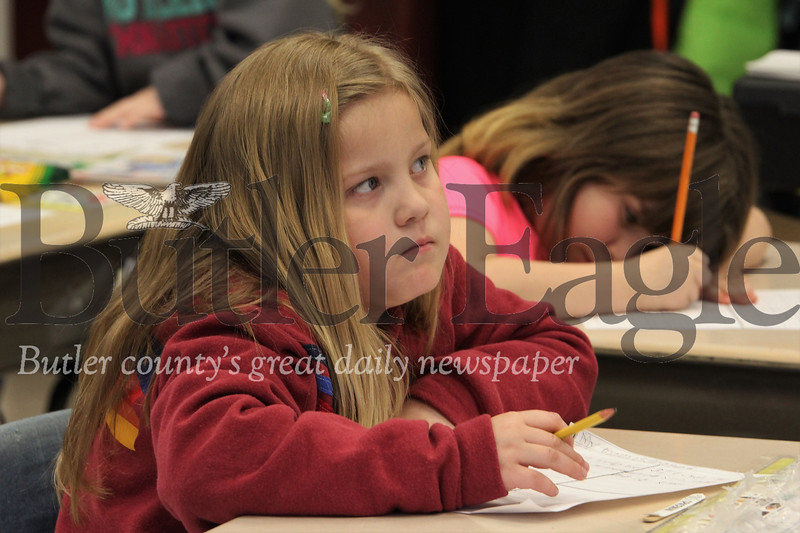 Maycie Livingston (first grade) contemplates what to write for her Mother's Day letter. Seb Foltz/Butler Eagle