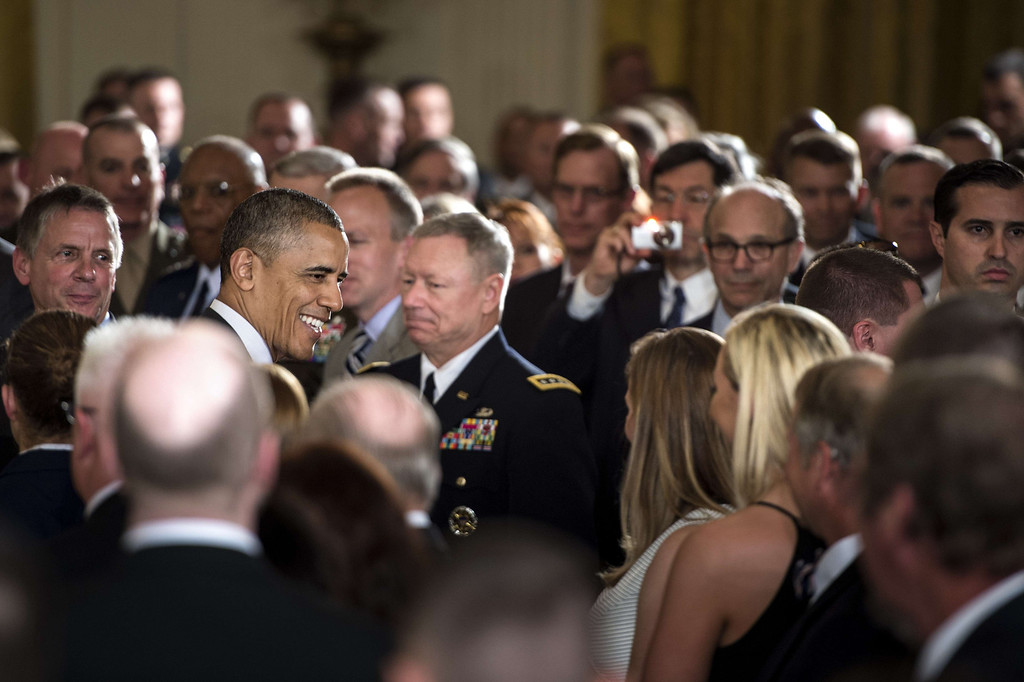 . US President Barack Obama smiles at attendees while leaving after a Medal of Honor ceremony in the East Room of the White House May 13, 2014 in Washington, DC.  AFP PHOTO/Brendan SMIALOWSKI/AFP/Getty Images