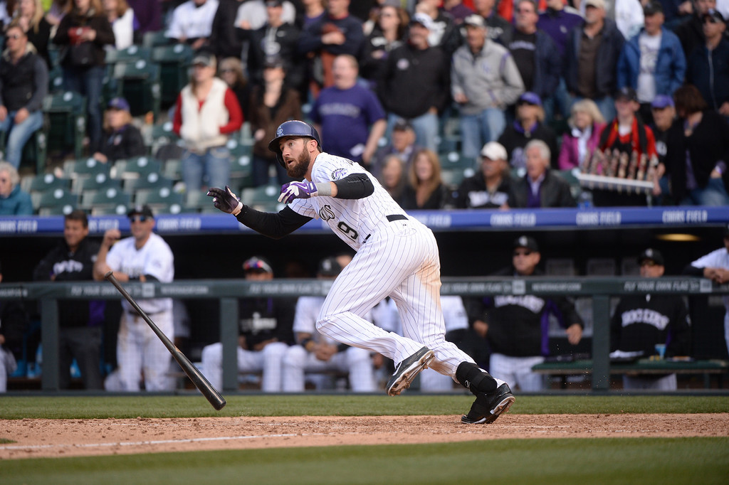 . DENVER, CO. - APRIL 4: Charlie Blackmon (19) reacts after hitting a double in the eighth inning. The Colorado Rockies hosted the Arizona Diamondbacks in the Rockies season home opener at Coors Field in Denver, Colorado Friday, April 4, 2014. (Photo by Karl Gehring/The Denver Post)