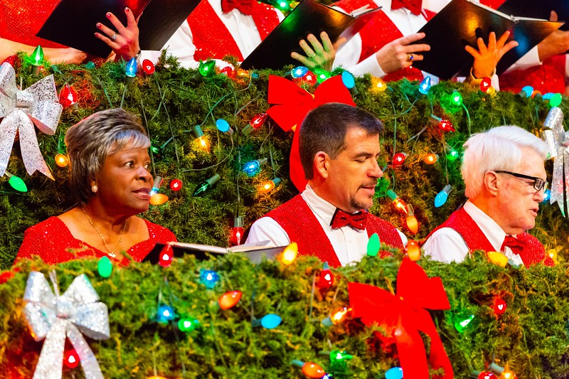 Members of the Living Christmas Tree Choir sing during the final performance of the Living Christmas Tree at the Dolly Hand Cultural Arts Center in Belle Glade on Sunday, December 2, 2018. [JOSEPH FORZANO/palmbeachpost.com]