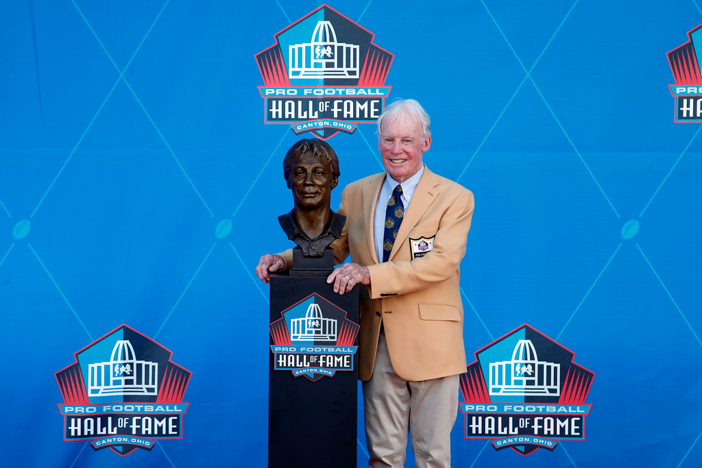 . NFL contributor Bobby Beathard poses with a bust of himself during an induction ceremony at the Pro Football Hall of Fame, Saturday, Aug. 4, 2018, in Canton, Ohio. (AP Photo/Gene J. Puskar)