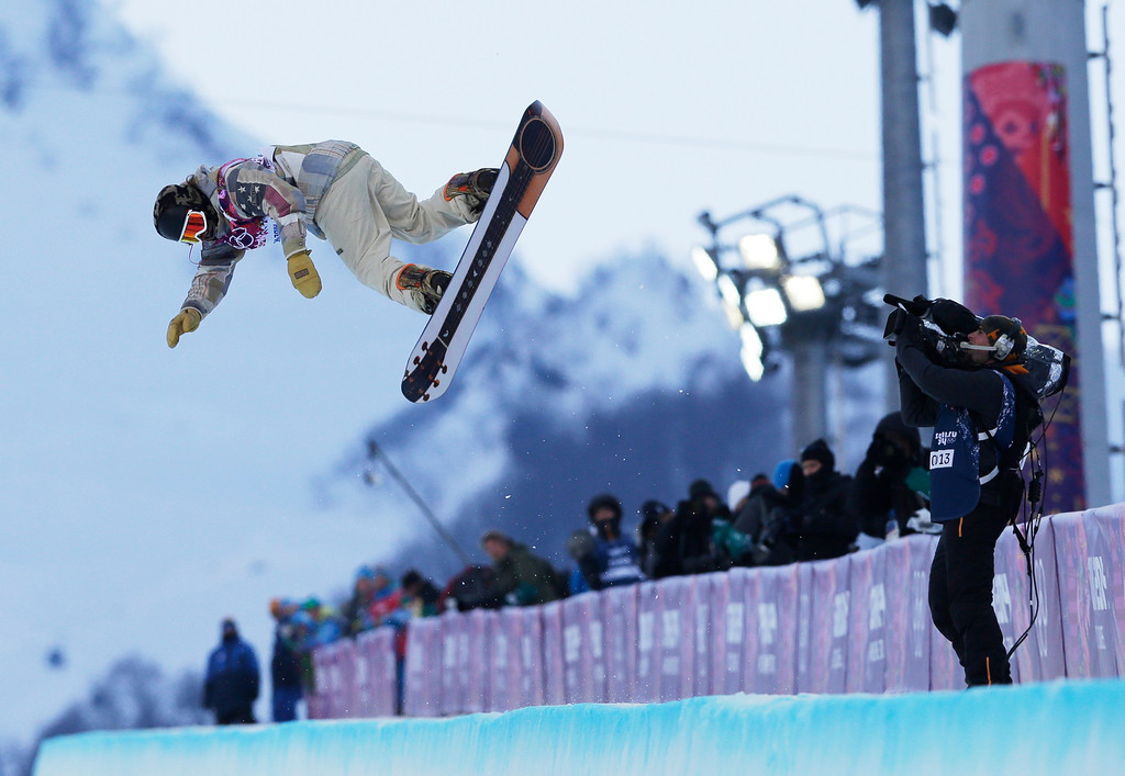 . Shaun White of the United States competes during the men\'s snowboard halfpipe qualifying session at the Rosa Khutor Extreme Park, at the 2014 Winter Olympics, Tuesday, Feb. 11, 2014, in Krasnaya Polyana, Russia. . (AP Photo/Andy Wong)