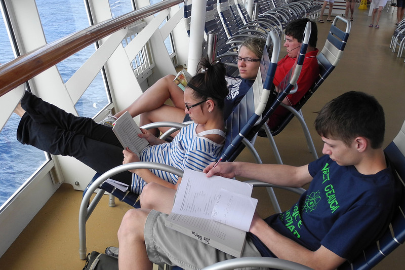 Doing school work on 4 of the 2700 deck chairs aboard