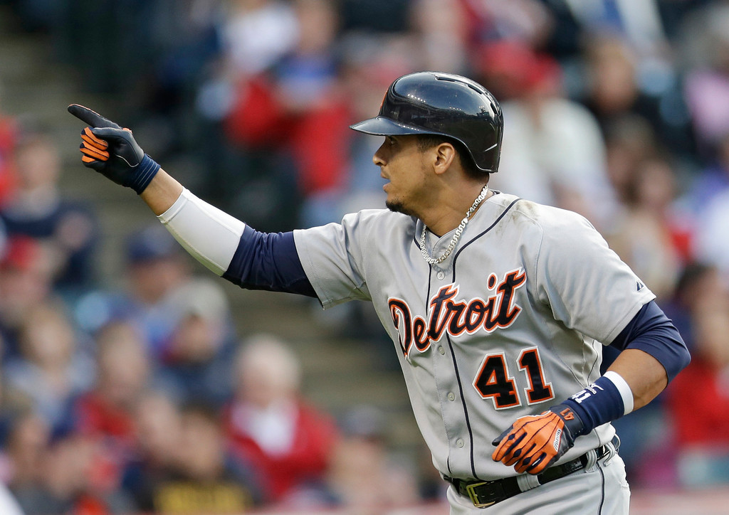 . Detroit Tigers\' Victor Martinez points upward after hitting a solo home run off Cleveland Indians starting pitcher Corey Kluber in the second inning of a baseball game, Monday, May 19, 2014, in Cleveland. (AP Photo/Tony Dejak)