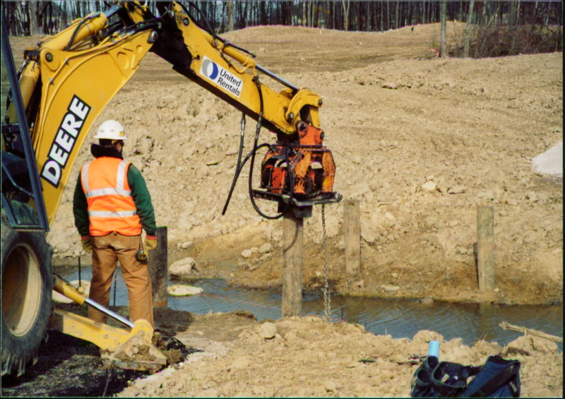 NPK C6C compactor on Deere backhoe-pile driving (24).JPG
