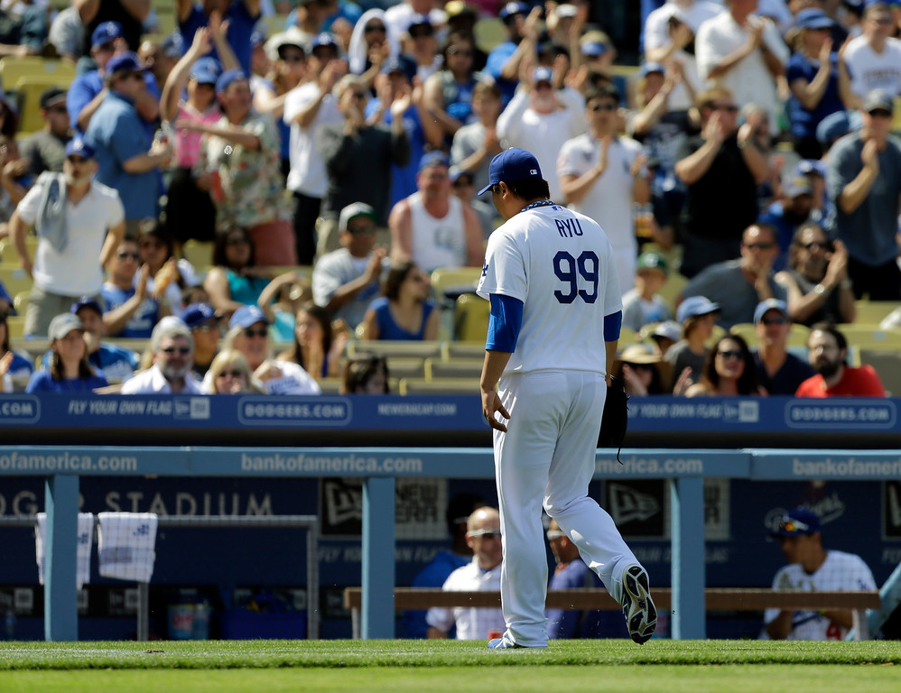 . Fans applaud as Los Angeles Dodgers pitcher Hyun-Jin Ryu comes out in the seventh inning of a baseball game against the Pittsburgh Pirates in Los Angeles, Sunday, April 7, 2013. Ryu earned his first major league win in the Dodgers\' 6-2 victory. (AP Photo/Reed Saxon)