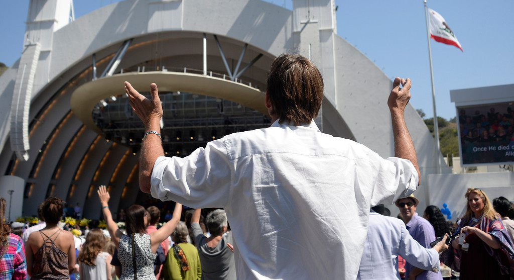. April 20,2014, Hollywood CA. People hold their hands up during prayer at the 2014 Hollywood bowl easter service by the Christian Assembly Church, Fellowship Monrovia, and Bel Air Presbyterian Church.  Photo by Gene Blevins/LA Daily News