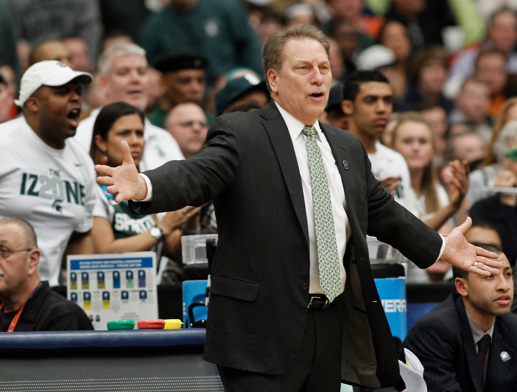 . Michigan State head coach Tom Izzo reacts to a call during the first half of a regional final against Louisville in the NCAA men\'s college basketball tournament Sunday, March 29, 2015, in Syracuse, N.Y. (AP Photo/Nick Lisi)