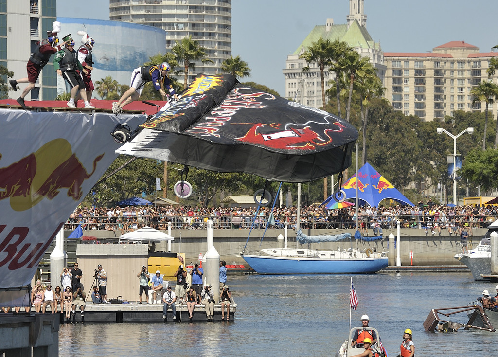 """. LONG BEACH, CALIF. USA -- Ronnie Shelton pilots his team\'s Flugtag entry \""""Sgt. Pepper\'s Flying Piano\"""" in Rainbow Harbor in Long Beach, Calif. on August 21, 2010. Thirty five teams competed in the Red Bull event where teams build homemade, human-powered flying machines and pilot them off a 30-foot high deck in hopes of achieving flight.  Flugtag means \""""flying day\"""" in German. They are on distance, creativity and showmanship..Photo by Jeff Gritchen / Long Beach Press-Telegram.."""