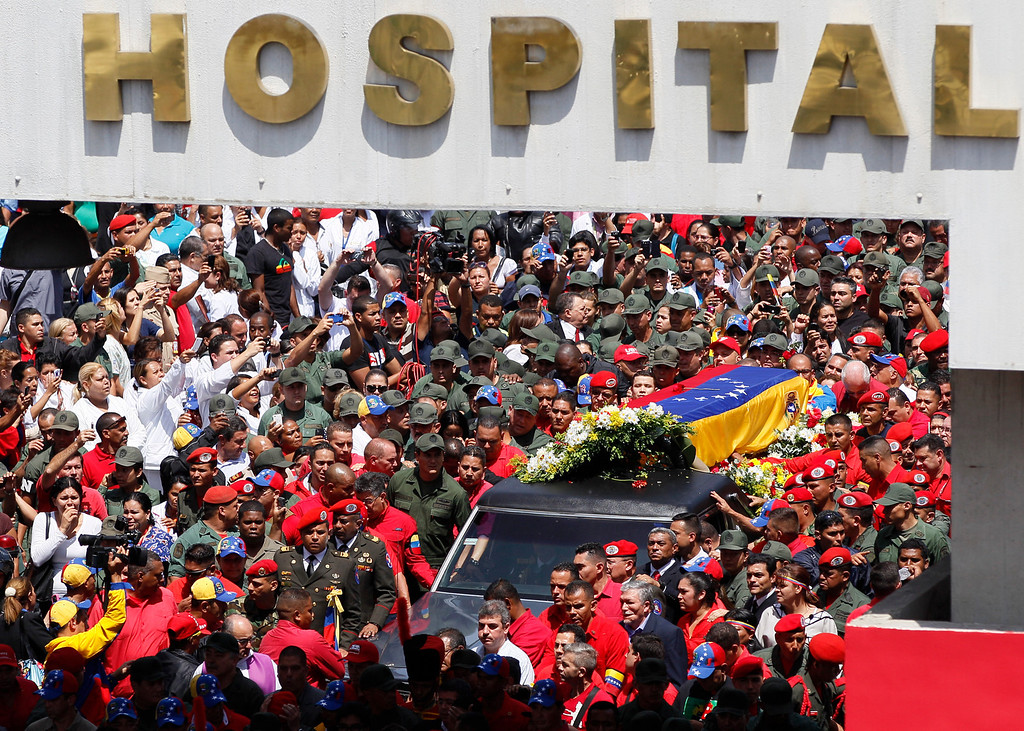 . The flag draped coffin containing the body of Venezuela\'s late President Hugo Chavez is taken from the hospital where he died, to a military academy where it will remain until his funeral in Caracas, Venezuela, Wednesday, March 6, 2013.  (AP Photo/Ariana Cubillos)