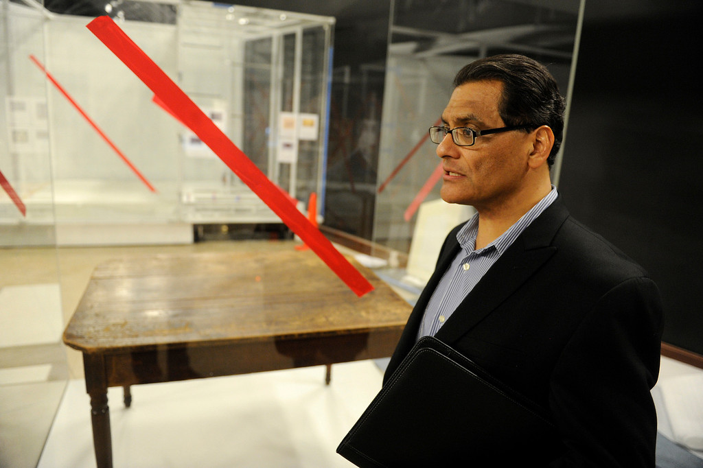 """. Curator Bill Estrada stands by the table used in the signing of the The Treaty of Cahuenga on display at the \""""Becoming Los Angeles\"""" exhibition set to open at the Natural History Museum of Los Angeles County in July. (Michael Owen Baker/Staff Photographer)"""