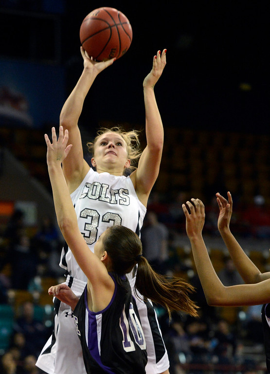. DENVER, CO. - MARCH 9TH: Mikala Gordon, Pueblo South, shoots over Kaylee Gatzke, Mesa Ridge High School, in the second half of the 4A �Great Eight� game at the Denver Coliseum, Saturday morning, March 9th, 2013. Pueblo South won 54-33 to advance to the Final Four at the CU Events Center, March 14th, 2013. (Photo By Andy Cross The Denver Post)