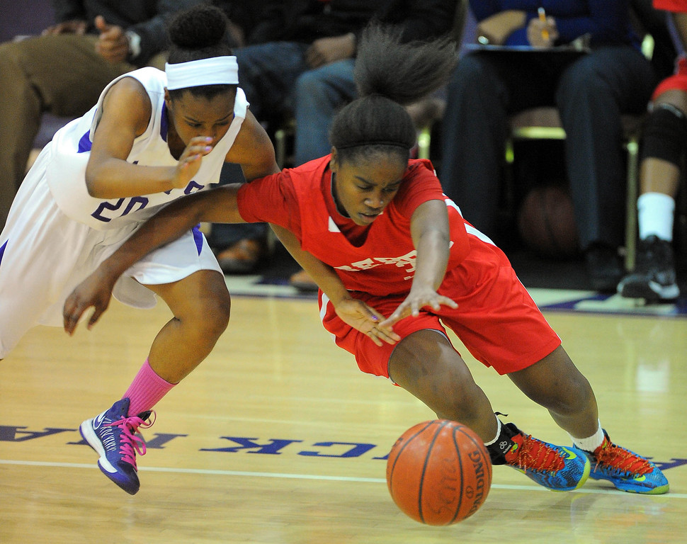 . LONG BEACH - 02/20/13 - (Photo: Scott Varley, Los Angeles Newspaper Group)  Serra and St. Anthony meet in the Quarterfinals of the Division 4AA CIF-SS girls basketball playoffs. St. Anthony\'s Nia Williams, left, and Serra\'s Siera Thompson dive after a loose ball.
