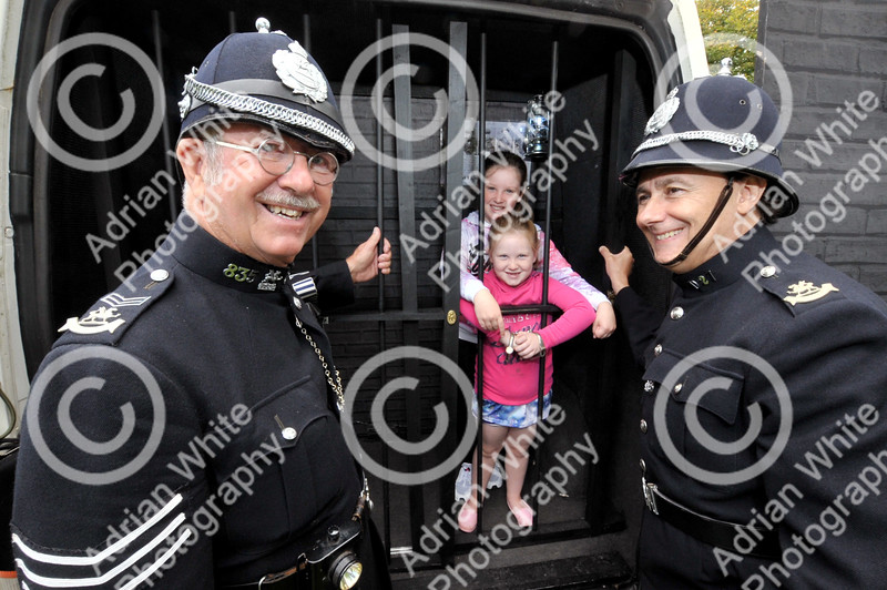 Skewen Motor Club Classic Car show.....annual classic car show... at Gnoll Park Sergeant William Harris and PC Franco Marco from 1900's Glamorgan Constabulary  locking up Libbi Simon aged 11 and her sister Ela-Mai aged 6. BYLINE - www.adrianwhitephotography.co.uk