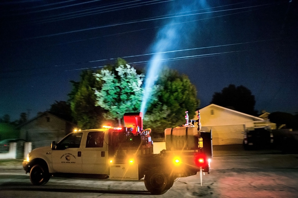 . Greater Los Angeles County Vector Control District Treatment spray anti-mosquito larvicide in a 90-acre area south of Garvey Avenue between Santa Anita and Central avenues in South El Monte on early Thursday morning, June 27, 2013. The larvicide is aimed at eradicating the disease-carrying Asian tiger mosquito.(SGVN/Staff photo by Watchara Phomicinda)